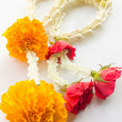Stock Photo: Flower garlands on white background.