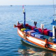 Stock Photo: Fishing boats anchored in sea, floating peacefully in harbo