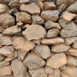 Brick wall made of rocks — Stock Photo