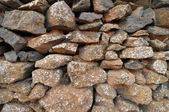 Brick wall made of rocks — Stock Photo