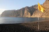 A Yellow Flag near the Atlantic Ocean on a Beach — Stock Photo