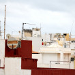 Antennas on a Roof over a Cloudy Sky — Stock Photo