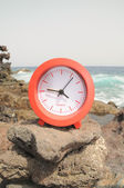 Red Clock Near the Ocean — Stock Photo