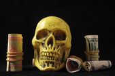 Death and Money Concept Skull and Currency — Stock Photo