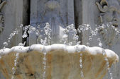 Water splashing out of a Marble Fountain — Stock Photo