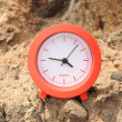 Stock Photo: Red Clock Near Ocean