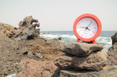 Red Clock Near the Ocean — Foto Stock