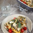 Baked polenta with vegetables - Stock Photo