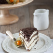 Rich cake with chocolate shavings — Stock Photo
