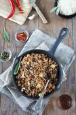 A typical Cuban picadillo - ground meat sauteed with vegetables and spices. It's served with white rice. — Stock Photo