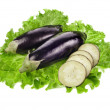 Aubergine eggplant with lettuce leaves isolated on white background — Stock Photo