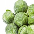 Brussels sprouts in closeup over white background - Stock Photo
