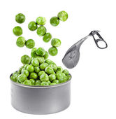 Canned green peas jumping out of a tin Isolated on white — Stock Photo