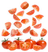 Falling slices ripe tomatoes — Stock Photo