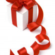 Little present box with red bow — Stock Photo #13835466