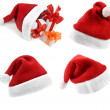 Santa Claus hat with Christmas presents — Stock Photo #13835748