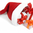 Santa Claus hat with Christmas presents — Stock Photo