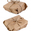 Parcel package wrapped with brown kraft paper tied rope isolated on white - Stok fotoğraf