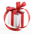 Present box with red ribbon bow isolated on white - Stok fotoğraf