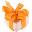 Beautiful gift cardboard box with orange ribbon bow isolated on white — Stock Photo #13835906