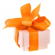 Beautiful gift cardboard box with orange ribbon bow isolated on white — Stock Photo #13835909