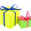 Stock Photo: Two gift colorful boxes with bows ribbons isolated on white background
