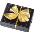 Gift box with gold bow — Stock Photo