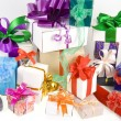Colorful gift boxes with bows isolated on white background — Stock Photo #13836112