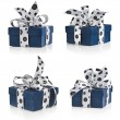 Present box wrapped ribbon bow with black spots isolated on white — Stock Photo