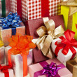 Many colorful gift boxes with ribbon bows — Stock Photo