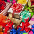 Many colorful gift boxes with ribbon bows — Stock Photo #13836180