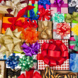 Many colorful gift boxes with ribbon bows — Stock Photo #13836187