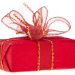 Present box with red ribbon bow isolated on white - Stock Photo