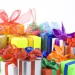 Colorful gift boxes with bows isolated on white background — Stock Photo #13836435