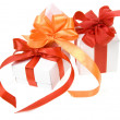 Christmas boxes with red ribbon bow — Stock Photo