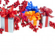 Royalty-Free Stock Photo: Present boxes with red christmas berries isolated on white