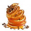 Christmas sliced dried orange with cinnamon and anise on a white background — ストック写真