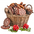 Christmas basket full cookies, holly berries on a white background — Stock Photo