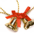 Christmas bells with red bows - Stock Photo