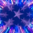 Fragment of the flag of the United States with lights blurred background — Stock Photo