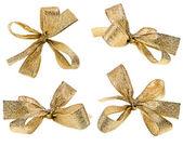 Hediyelik altın şerit yay üzerinde beyaz izole — Stok fotoğraf