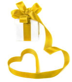 Present box with golden ribbon — Stock Photo