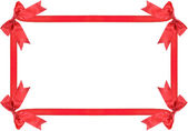 Red ribbon bow frame with copy space for your text — Stock Photo