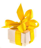 Beautiful gift cardboard box with yellow ribbon bow isolated on white — Stock Photo