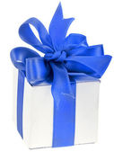 Present box with blue bow — Stock Photo