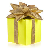 Yellow gift box with golden ribbon bow isolated on white — Stock Photo