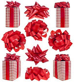 Collection of gift box in red checkered with red bow over white background — Stock Photo