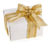 Gift box with golden ribbon bow isolated on white — Stock Photo