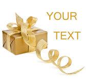 Boîte dorée avec arc de ruban blanc — Photo