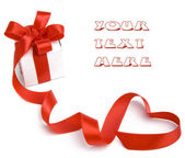 Present box with red ribbon bow in the form of hearts — Stock Photo